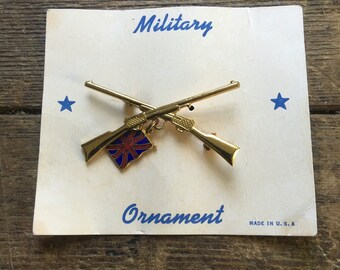 Military Ornament crossed rifles and union jacj