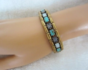 Vintage Panel Stretch Bracelet-elegant in style & comfortable to wear. 23 separate sections, mounted baguette shaped stones. Valentines gift
