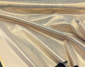 Luxurious manta ray Design Upholstery Fabric Vinyl Shiny gold. Sold by the yard