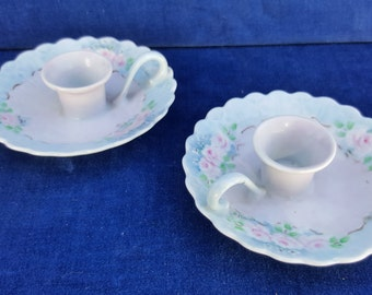 lovely pair of hand painted porcelain candle holders