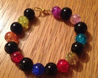 Black and coloured beaded bracelet with gold plated clasp