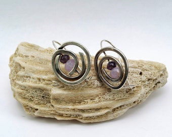 Sterling silver swirls with two shades of faceted Amethyst beads. Handmade.