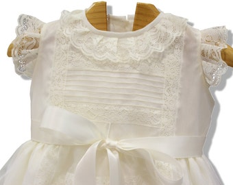 Baptism dress for baby girl made from ivory organza, ivory laces and front sattin bow. Special ocassion like Christening, weddings, birthday