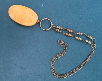 Boho beaded pendant necklace in blues, golds and browns