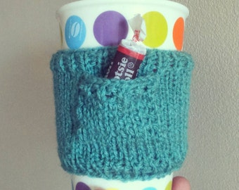 Hand knit cup cosy sleeve with pocket