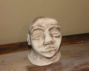 Ceramic sculpture of Koisan (Bushman).  Pottery, ceramic, face, handmade