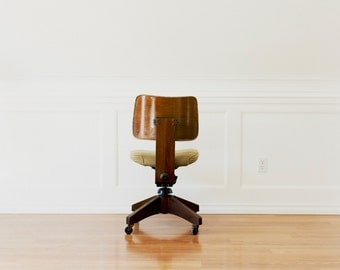 Mid century Rosewood Rolling Chair