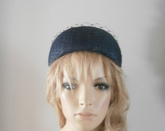 navy pillbox hat embellished with merry widow veiling & a cute bow detail to the rear