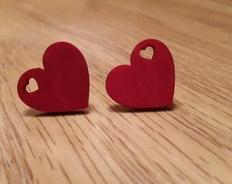 Red wooden heart earrings.