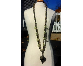Quoth The Raven - Antique Bronze Raven Skull Necklace Beaded with Moss Green Glass , Amber Glass and Glass Leaves