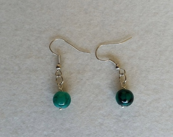 Sterling silver earrings with green glass drawbench beads
