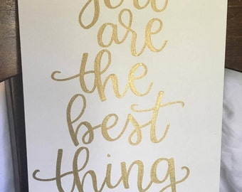 "Hand lettered on a 9x12 canvas panel ""You are the best thing"" in gold"