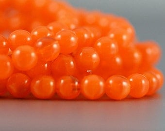 Czech Glass Druk Beads in Bright Orange Opalite 6mm