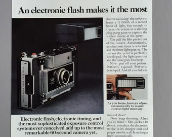 1969 Polaroid 360 Double Page Print Ad with Electronic Flash