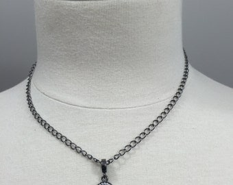 Gunmetal  chain necklace with a crystal cross charm