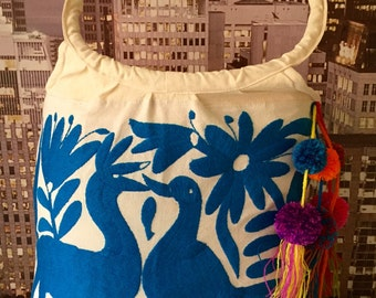 Bag, hand embroidered with blue Otomi with pompoms from Chiapas