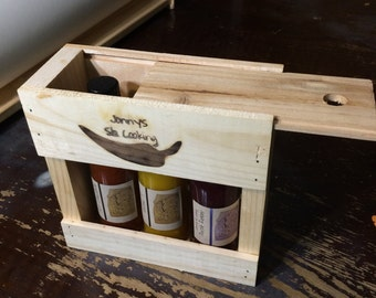 Hot sauce sampler gift pack with wooden box caddy jalapeno, mango habanero, chocolate habanero, fatalii