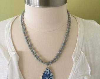 "Summer statement double strand of light gray opaque faceted glass beads with blue and white Asian floral design porcelain pendent, 21"" L."