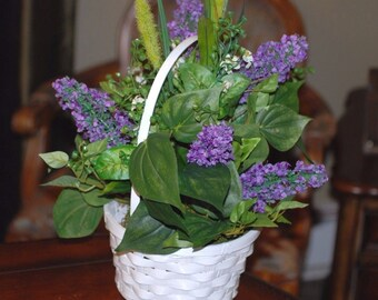 Purple Lilacs In A White Handle Basket