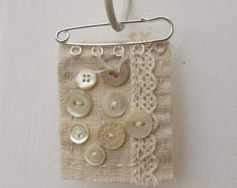 Fabric and button brooch, mother of pearl, cream linen