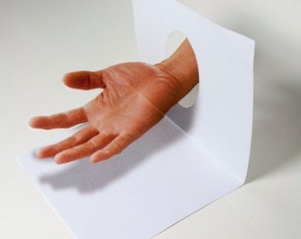 Anamorphic 3D illusion greeting card floating hand
