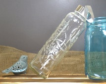 Hand Etched Glass Water Bottle with Whimsical Design.
