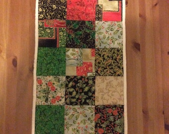 Festive patchwork and quilted table runner