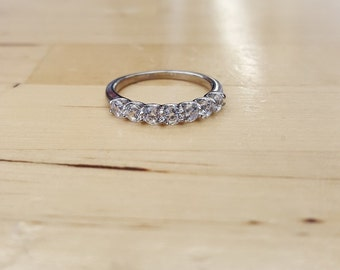 Stainless steel semi eternity ring for women with cubic zirconia stones