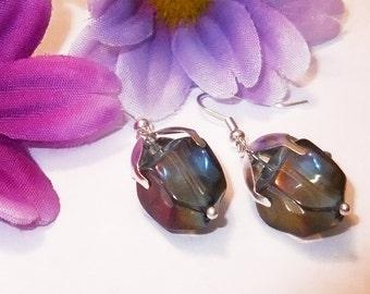 Earrings with purple green glass bead