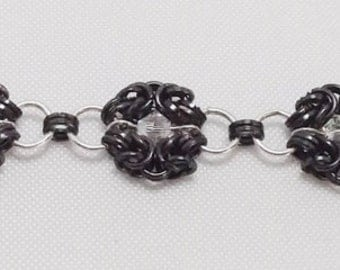 CB19: Byzantine in black and silver plated, with bicone crystals.