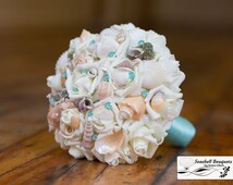Seashell wedding bouquet aqua pool blue with sea shells and pins on artificial silk flower roses for beach wedding and destination weddings
