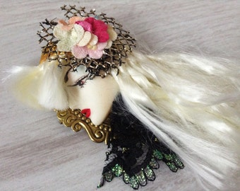 Woman face vintage brooch