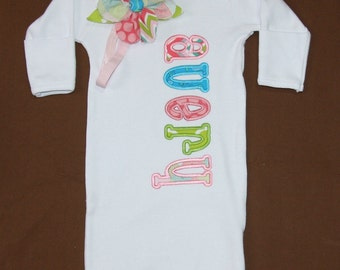 Custom appliqued infant gown with coordinating fabric hair bow