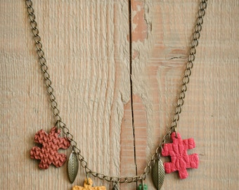 Necklace beads in the shape of puzzle pieces
