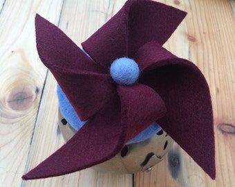 BORDEAUX . Felt pinwheel fascinator in burgundy and periwinkle.