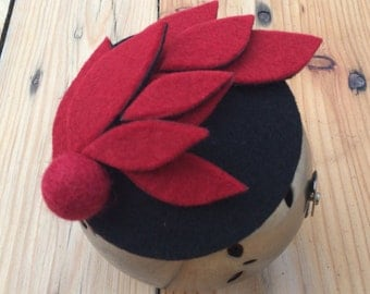 AKA.    Red and black felt fascinator/head piece/mini hat.