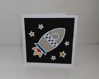 Handmade paper cut rocket card