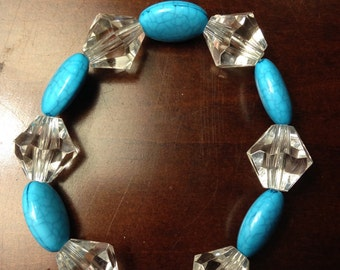 Handmade blue and clear or peach and clear beaded bracelets