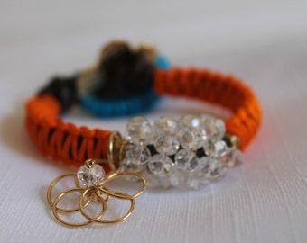 Leather  braided bracelet with crystals and gold field flower charm.