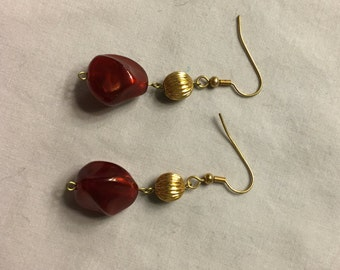 Gold and garnet dangle earrings on gold-tone fish-hook findings
