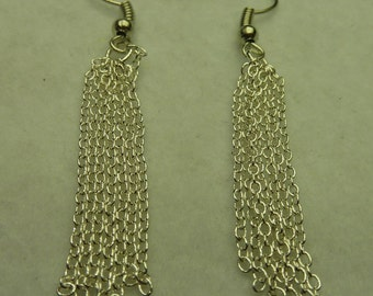 Long earrings with chains look