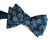 Atoms Bow Tie. Molecular model, atoms print science bowtie. Nucleus, electrons. Geek chic gift, nuclear medicine, atomic energy.