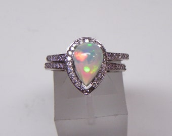 AAA Australian white Opal 0.86cts  in 14K White gold Bridal set .40cts of diamonds. 1619