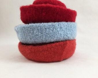 All wool hat shape, embellish with ribbon,beads,etc or use a base for needle felting