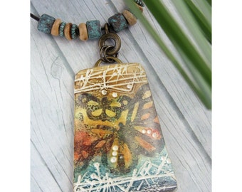 Polymer Clay Pendant Beach Boho Jewelry featuring Textured Butterfly Design in Dark Green, Orange, Yellow, Turquoise and White