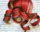 the S P I C E . Spice hair extension accent clip in 100% human hair brown auburn with bright bold red