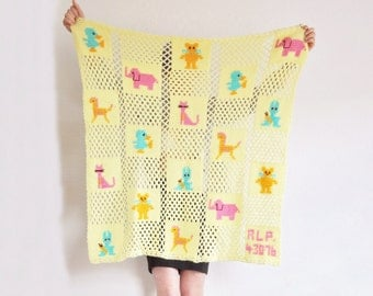 1976 pastel yellow baby blanket . animal babies . crocheted granny squares .sale s a l e