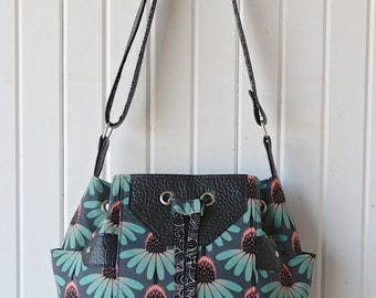 Dahlia Drawstring Bucket Bag in Pretty Potent in Aqua with black faux leather