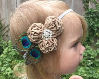Beautiful Peacock & Beige Rosettes headband with rhinestone center.  Perfect photo prop with our rompers, more colors available