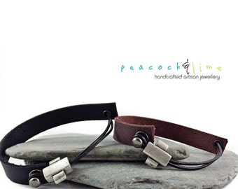 Simple leather bracelet with pewter plus sign slider bead // rugged leather strap silver pewter unisex bracelet // handmade